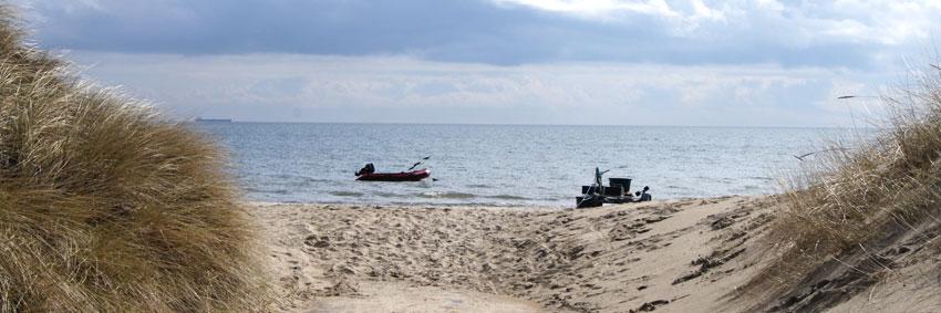 må man hente sand på stranden